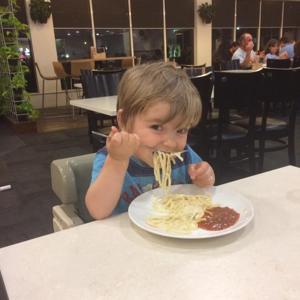 Toddler eating spaghetti